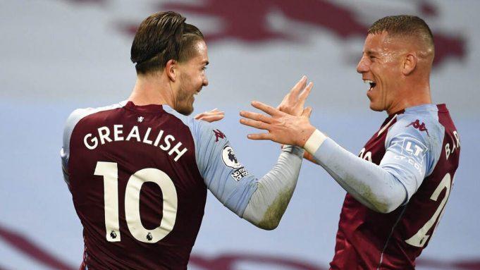 Pemain Aston Villa, Jack Grealish melakukan selebrasi bersama Ross Barkley, usai mencetak gol ke gawang Liverpool pada laga Liga Inggris di Stadion Villa Park, Minggu (4/10/2020). Liverpool takluk dengan skor 7-2.