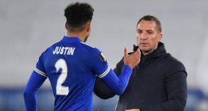 Pelatih Leicester City, Brendan Rodgers (kanan), memberi selamat kepada pemainnya, bek James Justin usai laga lanjutan Liga Europa 2020/21 Grup G melawan AEK Athens di King Power Stadium, Kamis (10/12/2020). Leicester City menang 2-0 atas AEK Athens.
